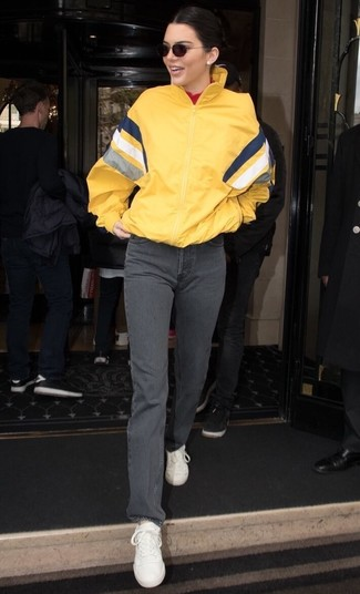 How to wear: white leather low top sneakers, grey jeans, red turtleneck, yellow windbreaker