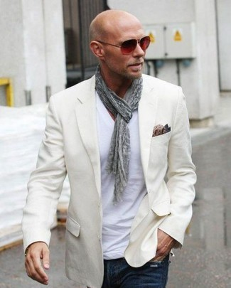 How to wear: brown paisley silk pocket square, navy jeans, white v-neck t-shirt, beige blazer
