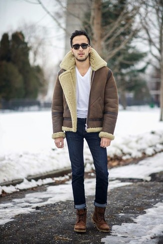 How to wear: brown leather casual boots, navy jeans, white v-neck t-shirt, brown shearling jacket