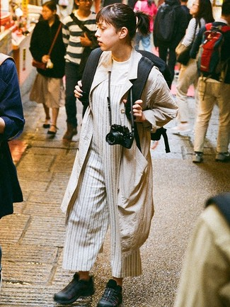 How to wear: black athletic shoes, grey vertical striped jumpsuit, white crew-neck t-shirt, beige duster coat