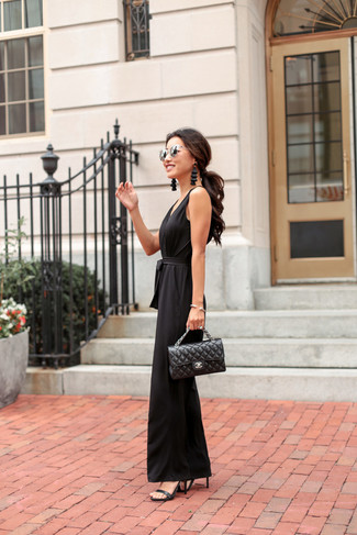 How to wear: black jumpsuit, black leather heeled sandals, black quilted leather satchel bag, silver sunglasses
