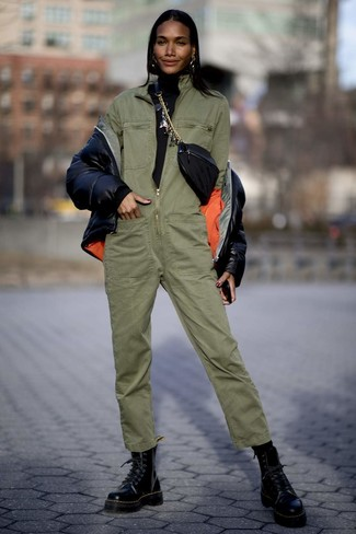 How to wear: black leather lace-up flat boots, olive jumpsuit, black turtleneck, black puffer jacket