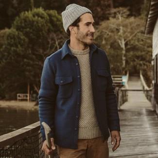 How to wear: grey beanie, khaki chinos, beige crew-neck sweater, navy wool shirt jacket