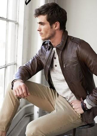 How to wear: khaki chinos, beige henley sweater, dark brown leather bomber jacket
