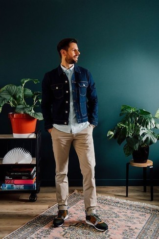 How to Wear Khaki Chinos: Opt for a navy denim jacket and khaki chinos to assemble an interesting and current casual ensemble. For a more relaxed feel, why not complement this ensemble with a pair of multi colored athletic shoes?