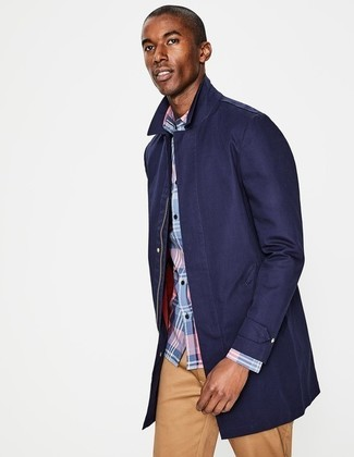 How to wear: khaki chinos, light blue plaid long sleeve shirt, navy raincoat