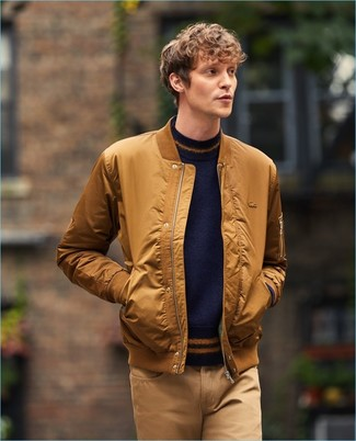 How to wear: khaki chinos, navy crew-neck sweater, tobacco bomber jacket