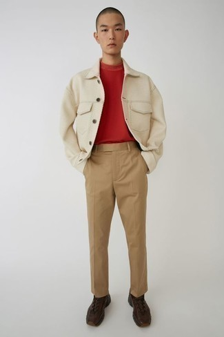 Teen Boy Fashion: What To Wear: This pairing of a beige shirt jacket and khaki chinos is on the line between classic and casual. And if you wish to immediately dial down this look with one single piece, finish off with dark brown athletic shoes. Surely a smart pick when it comes to fashion for teenage guys.