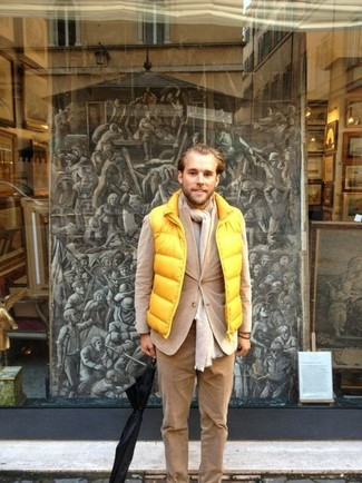 How to Wear Khaki Corduroy Chinos: Try teaming a yellow gilet with khaki corduroy chinos for a cool and casual and stylish getup.