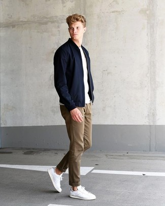 How to wear: white leather low top sneakers, khaki chinos, white crew-neck t-shirt, black bomber jacket