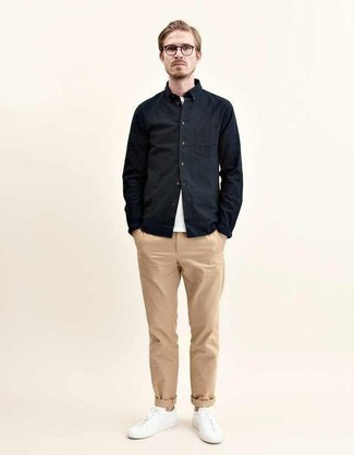 How to Wear a Black Long Sleeve Shirt For Men: Wear a black long sleeve shirt and khaki chinos to create an incredibly stylish and current relaxed casual ensemble. Break up this outfit with more relaxed shoes, such as these white leather low top sneakers.
