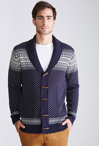 How to Wear a Navy Fair Isle Shawl Cardigan For Men: Solid proof that a navy fair isle shawl cardigan and khaki chinos look awesome when you pair them together in an off-duty look.