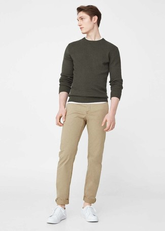 How to wear: white leather low top sneakers, khaki chinos, white crew-neck t-shirt, olive crew-neck sweater