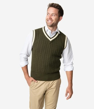 How to Wear Pants For Men: This combo of an olive sweater vest and pants is solid proof that a safe look can still be incredibly stylish.