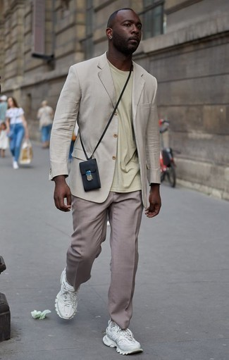 How to Wear Khaki Dress Pants For Men: This elegant combination of a beige blazer and khaki dress pants is really a statement-maker. Introduce a pair of white athletic shoes to the equation to infuse a dose of stylish effortlessness into this ensemble.