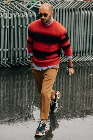 How to wear: charcoal athletic shoes, khaki wool dress pants, light blue vertical striped long sleeve shirt, red and black horizontal striped crew-neck sweater
