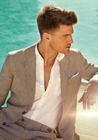 How to Wear a Beige Vertical Striped Blazer For Men: Combining a beige vertical striped blazer with khaki vertical striped dress pants is a savvy idea for a stylish and sophisticated ensemble.