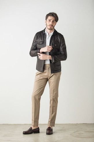How to Wear Dark Brown Leather Loafers For Men: This pairing of a dark brown leather biker jacket and khaki dress pants is a mix between formal and relaxed. And if you need to easily bump up this ensemble with a pair of shoes, introduce a pair of dark brown leather loafers to your look.