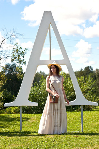 How to wear: khaki straw hat, brown leather crossbody bag, beige floral maxi dress