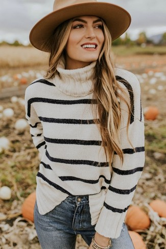 Women's Looks & Outfits: What To Wear In 2020: This casual combo of a white and black horizontal striped turtleneck and blue skinny jeans is extremely easy to throw together without a second thought, helping you look beyond chic and prepared for anything without spending too much time combing through your wardrobe.