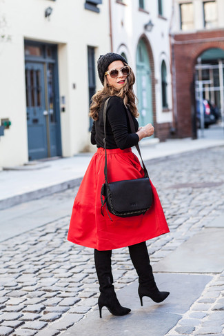 How to wear: black leather crossbody bag, black suede knee high boots, red full skirt, black crew-neck sweater
