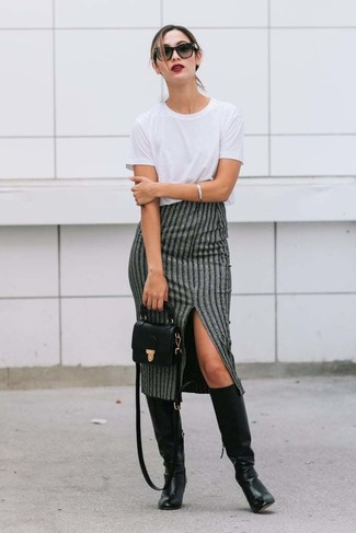 How to wear: black leather crossbody bag, black leather knee high boots, grey vertical striped midi skirt, white crew-neck t-shirt