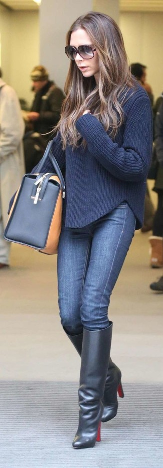 How to wear: tan leather duffle bag, black leather knee high boots, navy skinny jeans, navy cable sweater
