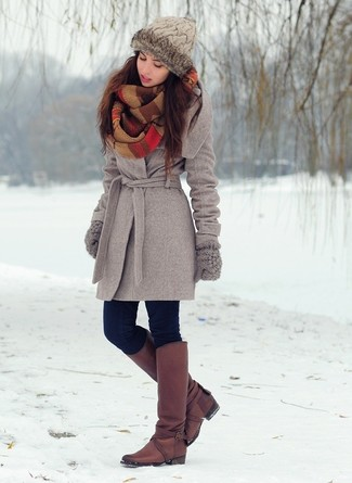 How to Wear Burgundy Leather Knee High Boots: A grey coat and navy skinny jeans are a nice combo to keep in your daily fashion mix. This look is finished off wonderfully with burgundy leather knee high boots.
