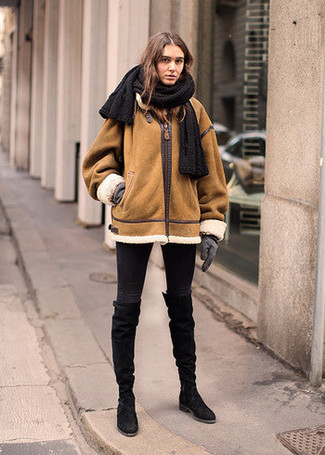 How to wear: grey wool gloves, black suede knee high boots, black skinny jeans, tobacco shearling jacket
