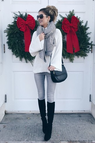 How to wear: black leather crossbody bag, black suede knee high boots, grey skinny jeans, white knit wool turtleneck