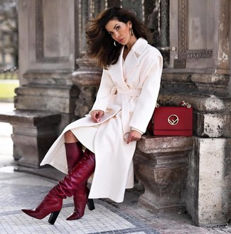 How to wear: red leather satchel bag, burgundy leather knee high boots, white sweater dress, white coat