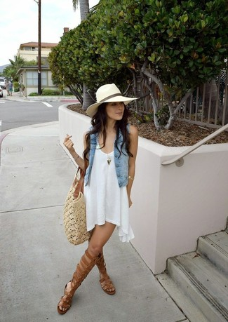 How to wear: beige crochet tote bag, brown leather knee high gladiator sandals, white swing dress, light blue denim vest