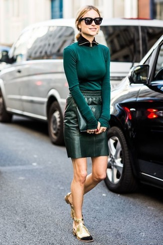 This combo of a teal long sleeve t-shirt and a dark green leather mini skirt is absolutely chic and yet it looks comfy and ready for anything. You could perhaps get a little creative when it comes to footwear and dress up your outfit with gold cutout leather lace-up ankle boots.