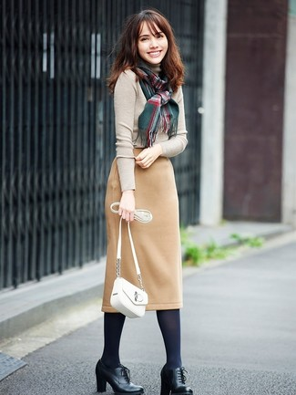 How to wear: white leather crossbody bag, black leather lace-up ankle boots, tan wool pencil skirt, beige turtleneck
