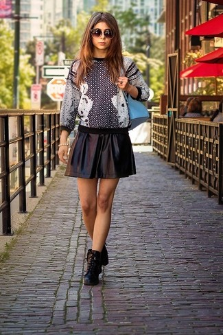 How to wear: light blue backpack, black leather lace-up ankle boots, black leather skater skirt, black and white print crew-neck sweater
