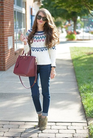 How to wear: burgundy leather tote bag, olive suede lace-up ankle boots, navy skinny jeans, white fair isle crew-neck sweater
