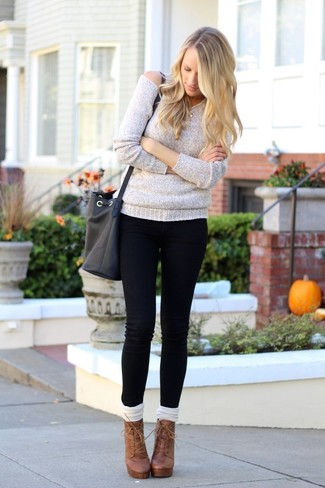 How to wear: white knee high socks, brown leather lace-up ankle boots, black skinny jeans, grey oversized sweater