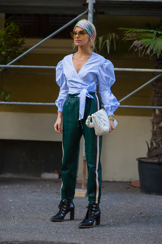 How to wear: white quilted leather tote bag, black leather lace-up ankle boots, dark green leather sweatpants, light blue long sleeve blouse