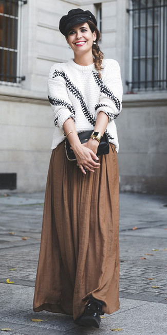 How to wear: black leather crossbody bag, black leather lace-up flat boots, brown pleated maxi skirt, white and black knit oversized sweater