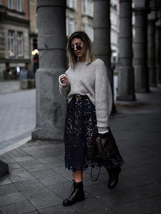 How to wear: black print leather backpack, black leather lace-up flat boots, black lace midi skirt, grey oversized sweater