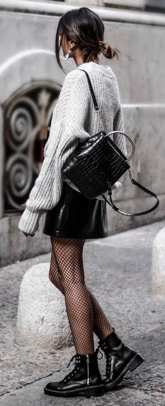 How to wear: black quilted leather backpack, black leather lace-up flat boots, black leather mini skirt, grey knit oversized sweater
