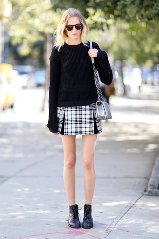How to wear: silver leather crossbody bag, black leather lace-up flat boots, black and white plaid mini skirt, black oversized sweater