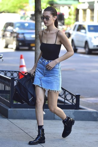 How to wear: black socks, black leather lace-up flat boots, light blue denim mini skirt, black tank