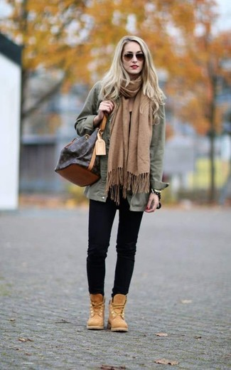 How to wear: dark brown leather bucket bag, tan nubuck lace-up flat boots, black skinny jeans, olive military jacket