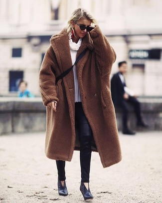 How to wear: black leather ankle boots, black leather leggings, white cowl-neck sweater, brown fur coat