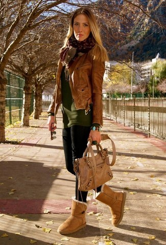 How to wear: tan uggs, black leggings, olive crew-neck sweater, brown leather biker jacket