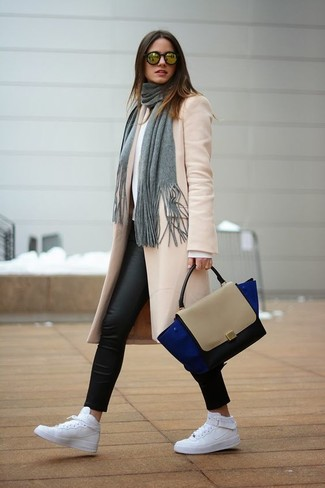 How to wear: white leather high top sneakers, black leather leggings, white crew-neck sweater, beige coat
