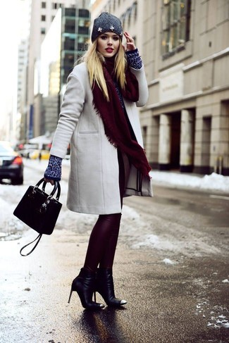 How to wear: black leather ankle boots, burgundy leather leggings, navy crew-neck sweater, grey coat