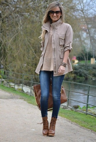 How to wear: brown leather lace-up ankle boots, blue denim leggings, beige crew-neck sweater, grey military jacket
