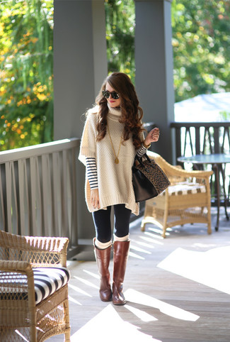 How to wear: brown leather knee high boots, black leggings, white and navy horizontal striped crew-neck sweater, beige poncho